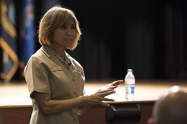 Navy Vice Adm. Raquel Bono, Defense Health Agency director, answers questions during a medical group meeting at Joint Base Charleston. The visit consisted of a consolidated mission brief, a strategic discussion with military medical senior leadership, a 628th Medical Group facility walking tour and ended with an in-depth question and answer session regarding the transition of Air Force military treatment facilities to DHA. (U.S. Air Force photo by Airman 1st Class Helena Owens)