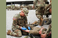 Army Capt. Lisa Kasper, an Emergency Room Nurse assigned to 3rd Brigade Combat Team, 101st Airborne Division (Air Assault), inserts an intravenous needle into a patient during a training exercise at Fort Campbell, Kentucky. (U.S. Army photo by Maj. John Moore)