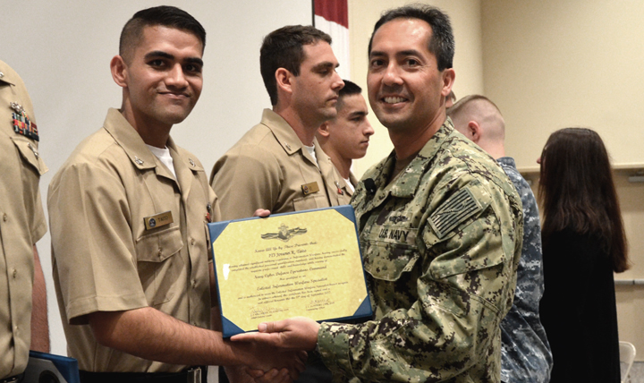 Navy Petty Officer 3rd Class Jovanei Taito, shown here receiving his information warfare qualification certificate, credits the ShipShape program for enabling him to pass the Navy's body composition and physical fitness assessments.  (Courtesy photo)