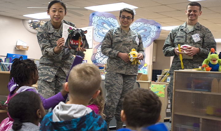 From left, Air Force Staff Sgt. Soohwa Ono, Senior Airman Vanessa Rivas and Capt. Daniel Chartrand promote pediatric oral hygiene at the Kelly Child Development Center. (U.S. Air Force photo by Staff Sgt. Kevin Iinuma)
