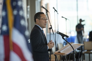 "Mr. Guy Kiyakawa, DHA Deputy Director, addresses guests, service members, caregivers and family members at the annual A Day of Healing Arts: From Clininc to Community event at the National Harbor Nov. 21, 2019. ""It's about all of you, we see you and we recognize your strength."""