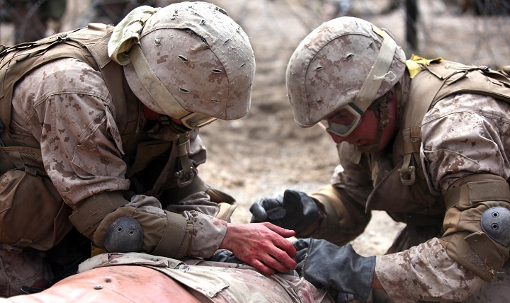 Navy corpsmen apply first aid to a training manikin during a training exercise. Since December 2016, every MARSOC special amphibious reconnaissance corpsman deploys with a supply of freeze-dried plasma and the experience to administer it. By October 2017, every MARSOC unit deployed will be outfitted with FDP. (U.S. Marine Corps photo by Lance Cpl. Joshua Young)