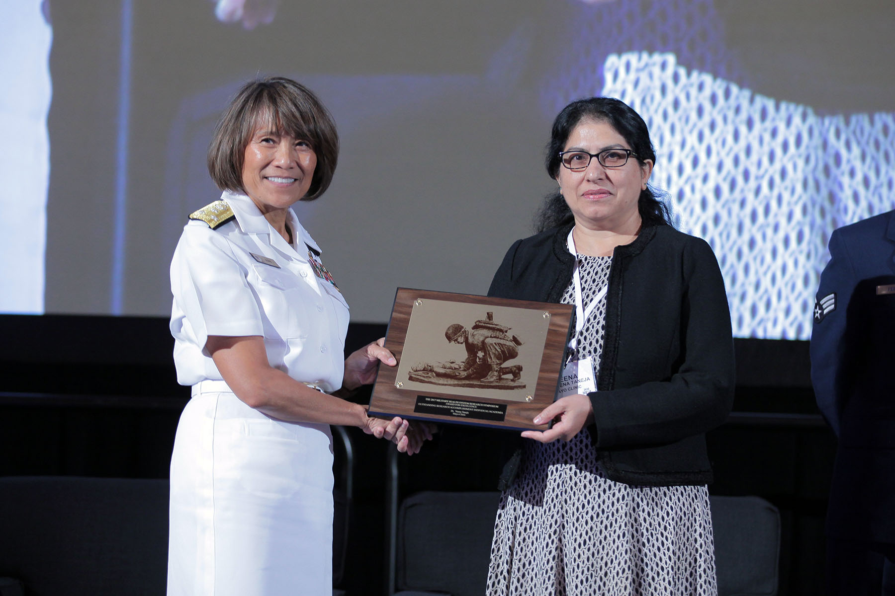 Vice Admiral Raquel C. Bono, director of the Defense Health Agency, presented Veena Taneja, Ph.D. with the 2017 Individual Research Accomplishment for academia, in the category of Precision Medicine, today at the Military Health System (MHS) Research Symposium. The Individual Research Accomplishment award recognizes outstanding contributions by an individual scientist that had a high impact on MHS research within the past year.  Taneja is an Associate Professor in the Department of Immunology at the Mayo Clinic, and her research centers on understanding the role of the immune system in the development of rheumatoid arthritis. She is recognized today for her research that discovered a new biomarker that can be used to treat inflammatory arthritis.