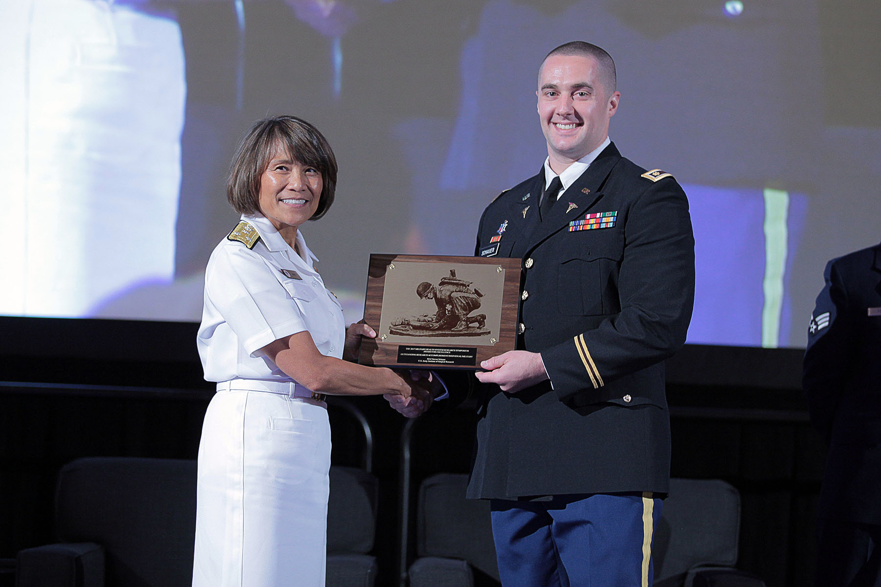 Vice Admiral Raquel C. Bono, director of the Defense Health Agency, presented U.S. Army Major Steven Schauer with the 2017 Individual Research Accomplishment for active duty service members, in the category of Military Operational Medicine, today at the Military Health System (MHS) Research Symposium. The Individual Research Accomplishment award recognizes outstanding contributions by an individual scientist that had a high impact on MHS research within the past year.  Schauer is an emergency medicine physician assigned to the U.S. Army Institute of Surgical Research. Over the past year, and while deployed, he made several significant contributions to military operational medicine through multiple research projects and policy recommendations.