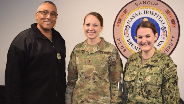 Navy Capt. Johannes Bailey, Naval Hospital Bremerton Director for Nursing Services (left) and Navy Lt. Kaitlyn Harmon, NHB Multi Service Unit (right), flank Army 1st Lt. Lauren Odegaard, from Madigan Army Medical Center, for a photo op after thanking her for her assistance. Odegaard provided assistance for the month of October in NHB's MSU to help with staffing shortages. (U.S. Navy photo by Douglas H. Stutz)