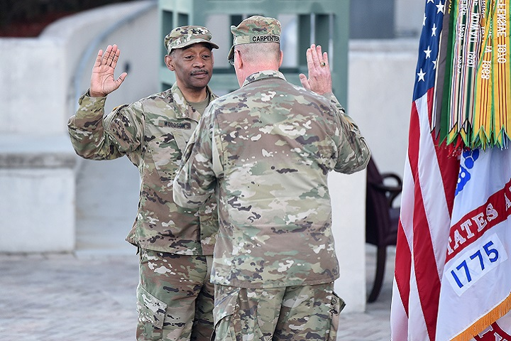 U.S. Army Reserve Maj. Gen. Jonathan Woodson, (left), incoming commanding general of Army Reserve Medical Command, reaffirms his commissioned officer oath of service with Maj. Gen. Scottie Carpenter, deputy commanding general for U.S. Army Reserve Command, during a promotion ceremony, March 31, 2019. Carpenter presided over the ceremony at the C. W. Bill Young Armed Forces Center in Pinellas Park, Florida. (U.S. Army photo by Anthony L. Taylor)