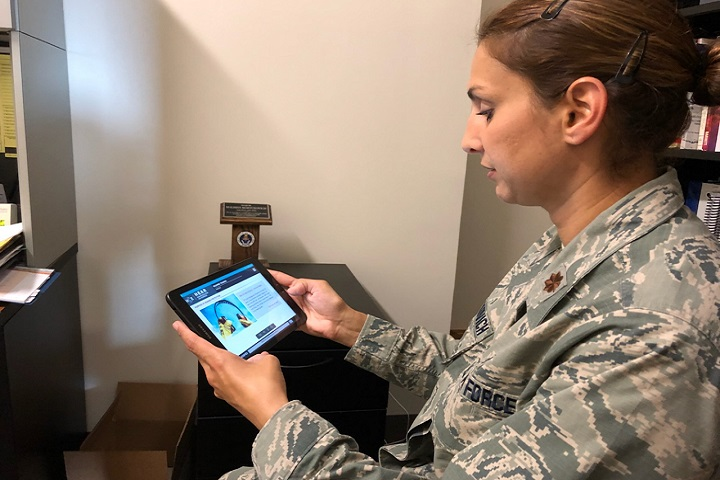 Maj. Malisha Martukovich, Air Force liaison for the DoD Hearing Center of Excellence, tests out the new HEAR course app, which can be downloaded onto a smartphone or tablet for convenient access. (DoD HCE photo)