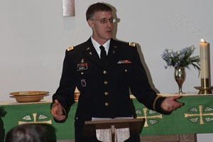 "Army Chaplain (Capt.) Andrew Braswell, chaplain clinician/senior pastor Protestant Chapel congregation at WRNMMC, explained how faith helps in dealing with holiday stress. ""Spirituality helps people see there is something greater than themselves. It helps put things in perspective and gives people hope."" (DoD photo)"