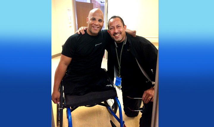 "Nurse Manny Santiago (right) with retired Marine Corps Sgt. Carlos Evans in October at Walter Reed National Military Medical Center in Bethesda, Maryland. Santiago said he ""had the privilege of taking care of this young man"" after Evans stepped on an improvised explosive device in Afghanistan in May 2010 during his fourth combat deployment. The two men discovered they're both from the same hometown in Puerto Rico. (Courtesy photo)"