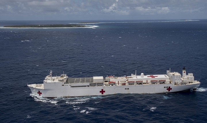 Navy hospital ship USNS Mercy transits the waters near the Ulithi Atoll while en route to the Mercy's first mission stop of Pacific Partnership 2018. PP18's mission is to work collectively with host and partner nations to enhance regional interoperability and disaster response capabilities, increase stability and security in the region, and foster new and enduring friendships across the Indo-Pacific Region. Pacific Partnership, now in its 13th iteration, is the largest annual multinational humanitarian assistance and disaster relief preparedness mission conducted in the Indo-Pacific. (U.S. Navy photo by Mass Communication Specialist 2nd Class Kelsey L. Adams)