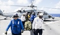 "Sailors transport a mock patient from an MH-60S Sea Hawk helicopter, attached to the ""Wildcards"" of Helicopter Sea Combat Squadron 23, to the triage center during a mass casualty integrated field exercise aboard the hospital ship USNS Mercy during Pacific Partnership 2018. (U.S. Navy photo by Mass Communication 2nd Class Kelsey L. Adams)"
