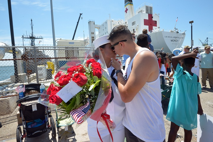 Navy Hospital Corpsman Tianna Garcia, assigned to Naval Medical Center San Diego, is greeted by her husband Aaron Garcia during the homecoming ceremony for the hospital ship USNS Mercy. The ship and her crew completed a five-month humanitarian relief mission to Southeast Asia. (U.S. Navy photo by Mass Communication Specialist 2nd Class Indra Beaufort)