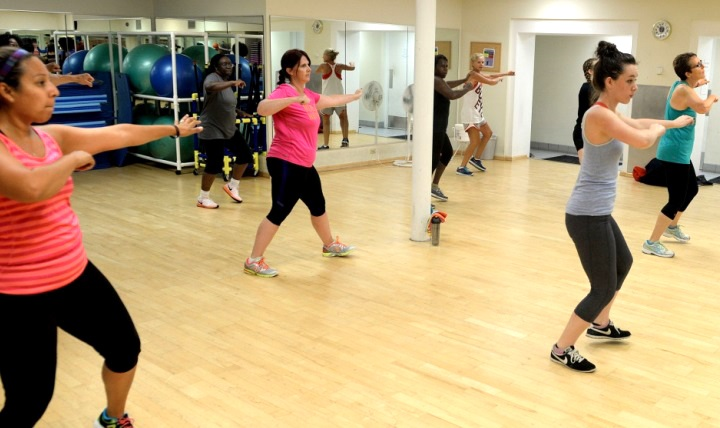People participate in a Zumba class dance – a Latin-inspired workout that helps burn calories while dancing.