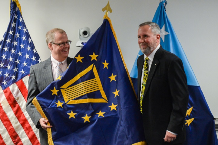 Principal Deputy Assistant Secretary of Defense for Health Affairs, Tom McCaffery presides over Mr. Darrell Landreaux's promotion to Deputy Assistant Secretary of Defense for Health Resources Management and Policy. (MHS photo)