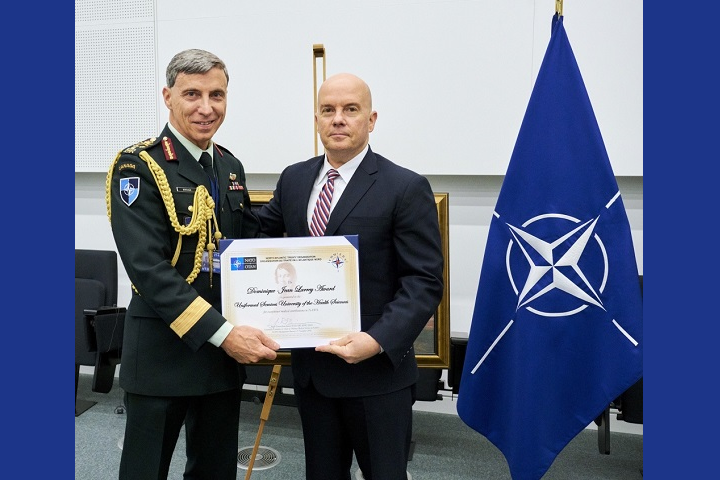 Major-General Jean-Robert Bernier (left), chair of NATO's Committee of Chiefs of NATO Medical Services, presents the 2018 Dominique-Jean Larrey Award to Dr. Richard Thomas, president of the Uniformed Services University of the Health Sciences. The Larrey Award is NATO's highest honor for medical support. (Photo courtesy of NATO)