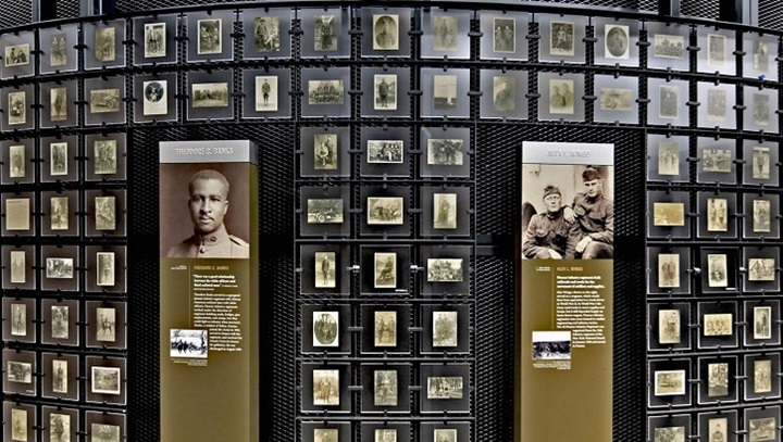 Wall in the museum with pictures and interactive displays