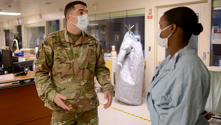 Image of two military nurses talking in a hospital hallway