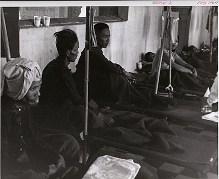 Cholera patients begin to recover after receiving special treatment prescribed by CAPT Robert Phillips and his medical research unit. They await transfer to the convalescent ward in the Cho Quan Hospital in the Saigon area (1964). (BUMED archives)