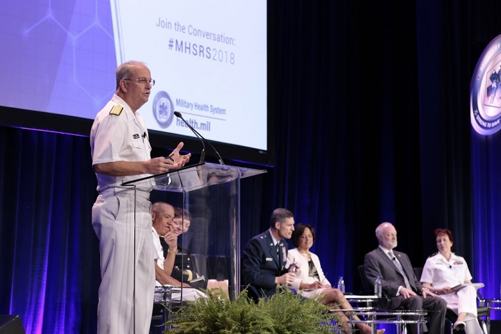 Navy Rear Adm. Bruce Gillingham, director, medical resources, plans and policy, Office of the Chief of Naval Operations, and other senior leaders speak at the general officer round-table discussion during the 2018 Military Health System Research Symposium. (MHS photo)