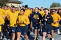 Navy Reserve Sailors assigned to Navy Operational Support Center, Phoenix perform a 1.5-mile run during the physical readiness test at Luke Air Force Base in Glendale, Arizona. (U.S. Navy photo by Mass Communications Specialist 3rd Class Drew Verbis)