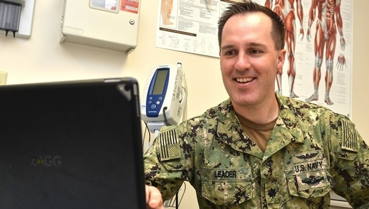 Soldier in front of a computer monitor