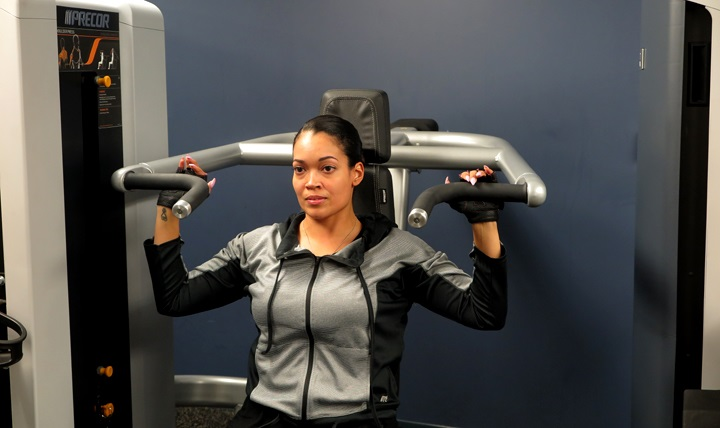 "Elizabeth Harris, fitness center manager at Defense Health Headquarters (DHHQ) partakes in a workout session. Harris considers herself to be a fitness 'lifer'and says, ""Being healthy is not a hobby; it's a lifestyle."""