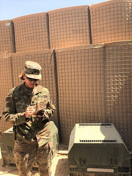 Image of soldier with a noise detector