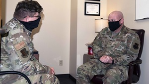 Military personnel wearing face masks talking