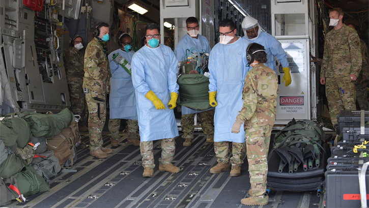 12 COVID-19 patients aboard a C-17 Globemaster III aircraft