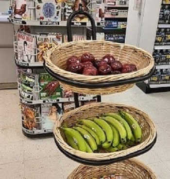 Two baskets full of  fresh apples and bananas