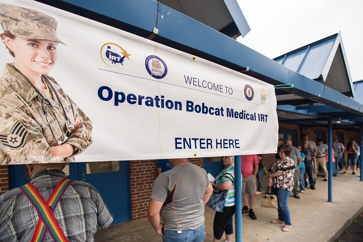 Area residents line up outside Lee County High School in Beattyville, Kentucky to receive treatment at a health-care clinic being operated by the Air National Guard and U.S. Navy Reserve. The clinic is one of four that comprised Operation Bobcat, a 10-day mission to provide military medical troops with crucial training in field operations and logistics while offering no-cost health care to the residents of Eastern Kentucky. (U.S. Air Force photo by Lt. Col. Dale Greer)
