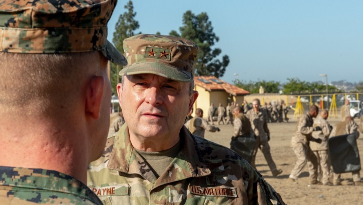 Image of Gen. Payne speaking with a soldier