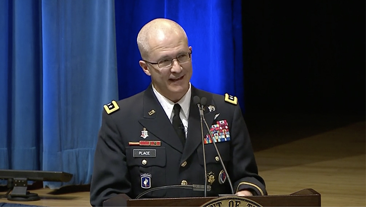Defense Health Agency Director Army Lt. Gen. Ronald Place speaks at a podium.
