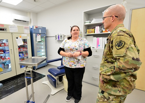 Allison Payne, an Army Nurse with the Stuttgart Army Health Clinic Immunizations Department, provides a mission overview to Lt. Gen. Ronald J. Place, the new Director of the Defense Health Agency, during his visit to Stuttgart on Sept. 11. Place was the Keynote Speaker at the TRICARE Eurasia Africa Commanders and Stakeholders Meeting at Sembach Kaserne, Germany, Sept 9-13. During the visit, he also met with senior military leaders and Surgeons General from Unified Combatant Commands. (DoD photo)
