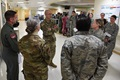 Air Force Col. Michelle Aastrom, 81st Inpatient Operation Squadron commander, discusses the intensive care unit capabilities with Army Maj. Gen. Ronald Place, Defense Health Agency, director, for the National Capital Region Medical Directorate and Transition Intermediate Management Organization, during an immersion tour inside the Keesler Medical Center at Keesler Air Force Base, Mississippi, recently. The purpose of Place's two-day visit was to become more familiar with the medical center's mission capabilities and to receive the status of the 81st Medical Group's transition under DHA. (U.S. Air Force photo by Kemberly Groue)