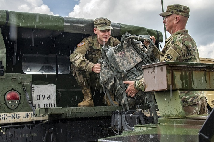Ahead of Hurricane Florence, South Carolina National Guard soldiers load gear into a Humvee. Approximately 1,600 Soldiers and Airmen in the state have been mobilized to respond to recovery efforts as forecasters warn of a potential Category 4 storm and a projected landfall near the Carolinas. (U.S. Army photo by Staff Sgt. Erica Knight)
