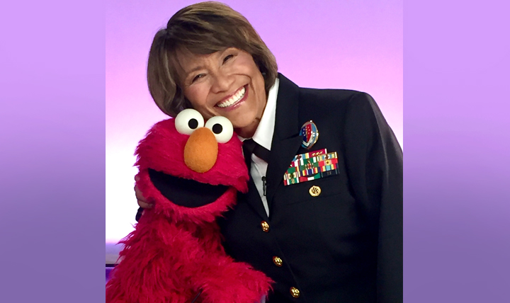 "Defense Health Agency Director Vice Admiral Raquel ""Rocky"" Bono joined Sesame Street's Elmo to record a welcome video for the new provider section of the Sesame Street for Military Families website. (Photo by MHS Communications)"