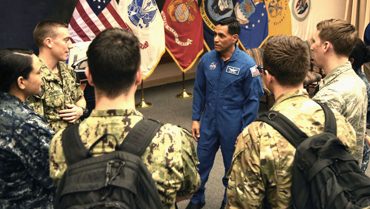 Army Maj. Frank Rubio is surrounded by Uniformed Services University students with additional questions after a panel discussion about opportunities to work with and for NASA. (Photo courtesy of USU)