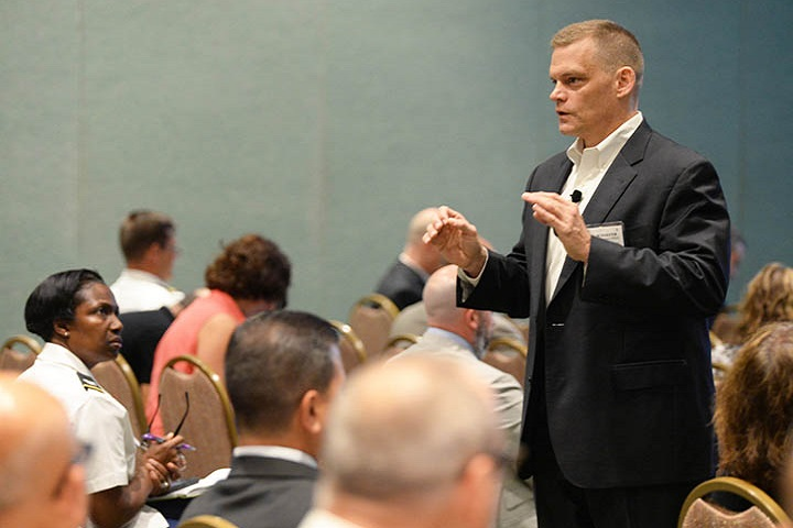 "On July 25, 2018, Mr. Craig Schaefer, the DoD Healthcare Management System Modernization Program Manager, spoke at the Defense Health Information Technology Symposium (DHITS) about how lessons learned from initial MHS GENESIS sites in the Pacific Northwest can improve future deployments. DHITS is an annual conference that brings together military health leaders from across the Military Health System to discuss strategies and Health IT solutions. ""One Team, One Mission - Creating Our Future Together"" (MHS photo)"