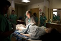 Regina Vadney, nurse midwife, William Beaumont Army Medical Center, evaluates a medical manikin using WBAMC's new simulation system which provides cutting-edge training to medical staff during a simulated postpartum hemorrhage scenario. The new simulation system aims to increase communication, and improve interdisciplinary and clinical performance of staff when treating obstetric emergencies. (U.S. Army photo by Marcy Sanchez)