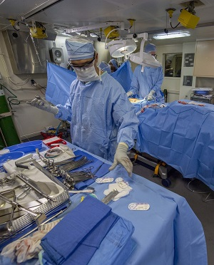 Navy Cmdr. Jeffrey Chao, the Littoral Combat Group One, surgeon, performs an emergency appendectomy aboard the San Antonio-class amphibious transport dock ship USS Somerset. (U.S. Navy photo by Mass Communication Specialist 1st Class Andrew Brame)