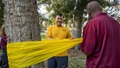 Navy Boatswain's Mate 2nd Class Sebastian Castano, an assistant suicide prevention coordinator assigned to Naval Station Mayport, ties a yellow ribbon around a tree at Mayport Memorial Park in recognition of Suicide Awareness Month. Participants tied yellow ribbons to represent the 46 active duty Sailors lost to suicide in 2019. (U.S. Navy photo by Mass Communication Specialist 3rd Class Alana Langdon)