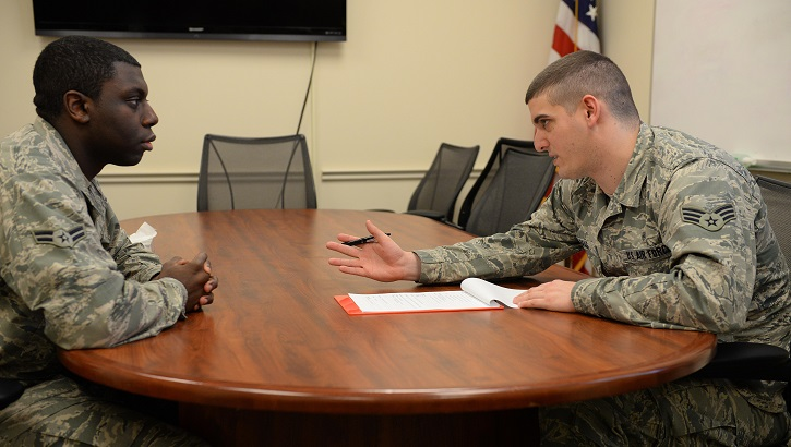 Senior Airman Brandon Haag goes through new patient paperwork, Feb. 9, 2015, at the Mental Health clinic on Scott Air Force Base, Ill. A typical protocol when a new patient comes in is getting to know the background history of the patient to help them and the provider they will see know what will help in a crisis or difficulty. Haag is a 375th Medical Group mental health technician. (U.S. Air Force photo/Airman 1st Class Erica Crossen)