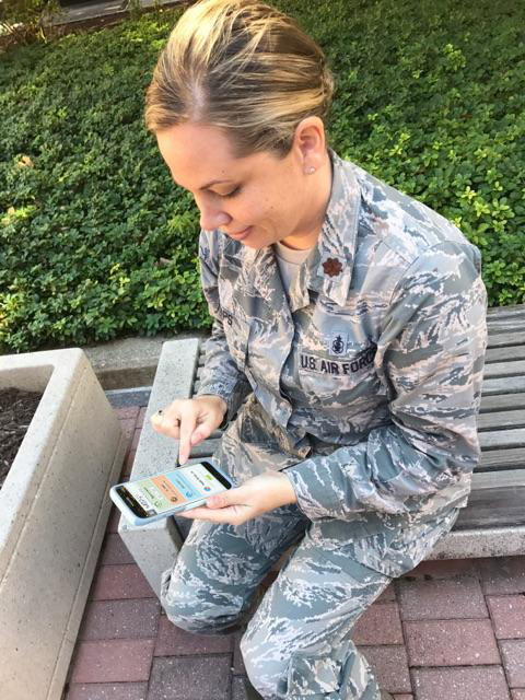 Air Force Maj. Stephanie Raps uses her smartphone to access the TRICARE Online Patient Portal.