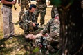 Soldiers at Fort Benning, Georgia, train one another on using the Tactical Combat Casualty Care Exportable system, a medical trauma training mannequin. Personnel from the office of the Program Executive Officer for Simulation, Training and Instrumentation, brought new, technologically advanced medical training mannequins to Fort Benning to increase the realism of medical trauma training and ultimately to save lives and limbs. (U.S. Army photo by Patrick Albright)