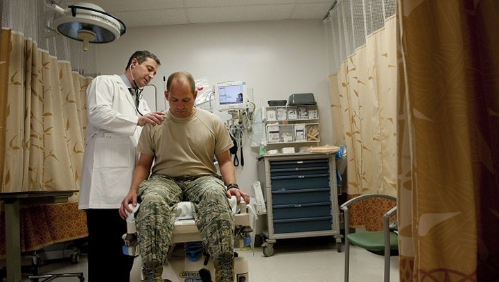 Sean Harap, Tripler Army Medical Center physician, performs a physical exam for U.S. Air Force Capt. Joshua Gscheidmeier, 128th Air Refueling Wing, at Tripler Army Medical Center May 8, 2014, in Honolulu.  (U.S. Air Force photo by Staff Sgt. Christopher Hubenthal)