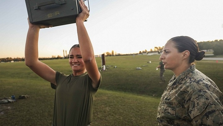 Marine Corps Pfc. Barbara Pujolllopiz, (left), an administrative specialist with the 22nd Marine Expeditionary Unit, performs ammo can lifts while Capt. Katheryn Evazich, the MEU's adjutant, observes and counts repetitions during a Combat Fitness Test aboard Camp Lejeune, North Carolina. The CFT is an annual Marine Corps physical training requirement in the which assesses combat readiness. (U.S. Marine Corps photo by Cpl. Tawanya Norwood)