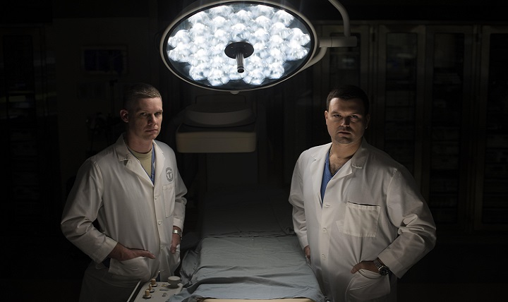 Air Force Lt. Col. Jason Compton (left) and Air Force Maj. Chales Chesnut, 99th Medical Group general surgeons, pose for a portrait in the Mike O'Callaghan Military Medical Center at Nellis Air Force Base, Nevada. The surgeons were two members of the team that took in trauma patients at the University Medical Center of Southern Nevada during the Las Vegas shooting Oct. 1, 2017. (U.S. Air Force photo by Senior Airman Kevin Tanenbaum)