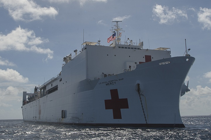 The hospital ship USNS Mercy anchors in shallow water during a Pacific Partnership stop. (PP18). PP18's mission is to work collectively with host and partner nations to enhance regional interoperability and disaster response capabilities, increase stability and security in the region, and foster new and enduring friendships across the Indo-Pacific Region. (U.S. Navy photo by Mass Communication Specialist 3rd Class Cameron Pinske)