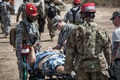 Airmen and Soldiers from the 3rd Chemical, Biological, Radiological, Nuclear Task Force, Pennsylvania National Guard, evacuate a casualty actor during the exercise Vigilant Guard, at Camp Santiago in Salinas, Puerto Rico. Members of the Pennsylvania and Puerto Rico National Guard worked together to provide joint disaster relief training. (U.S. Air National Guard photo by Staff Sgt. Tony Harp)
